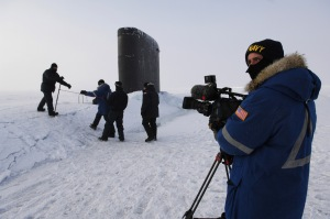 070317-N-3642E-198 	Navy Petty Officer 2nd Class Andrew Krauss prepares to videotape visitors to the Los Angeles-class fast-attack submarine USS Alexandria (SSN 757) in the Arctic Ocean on March 17, 2007.  Alexandria is taking part in exercise ICEX 07 with the Royal Navy submarine HMS Tireless (SS 88) and the applied physics ice station.  The exercise is in support of arctic testing for U.S. and United Kingdom submarines being conducted on and under a drifting ice floe about 180 nautical miles off the north coast of Alaska.  DoD photo by Chief Petty Officer Shawn P. Eklund, U.S. Navy.  (Released)